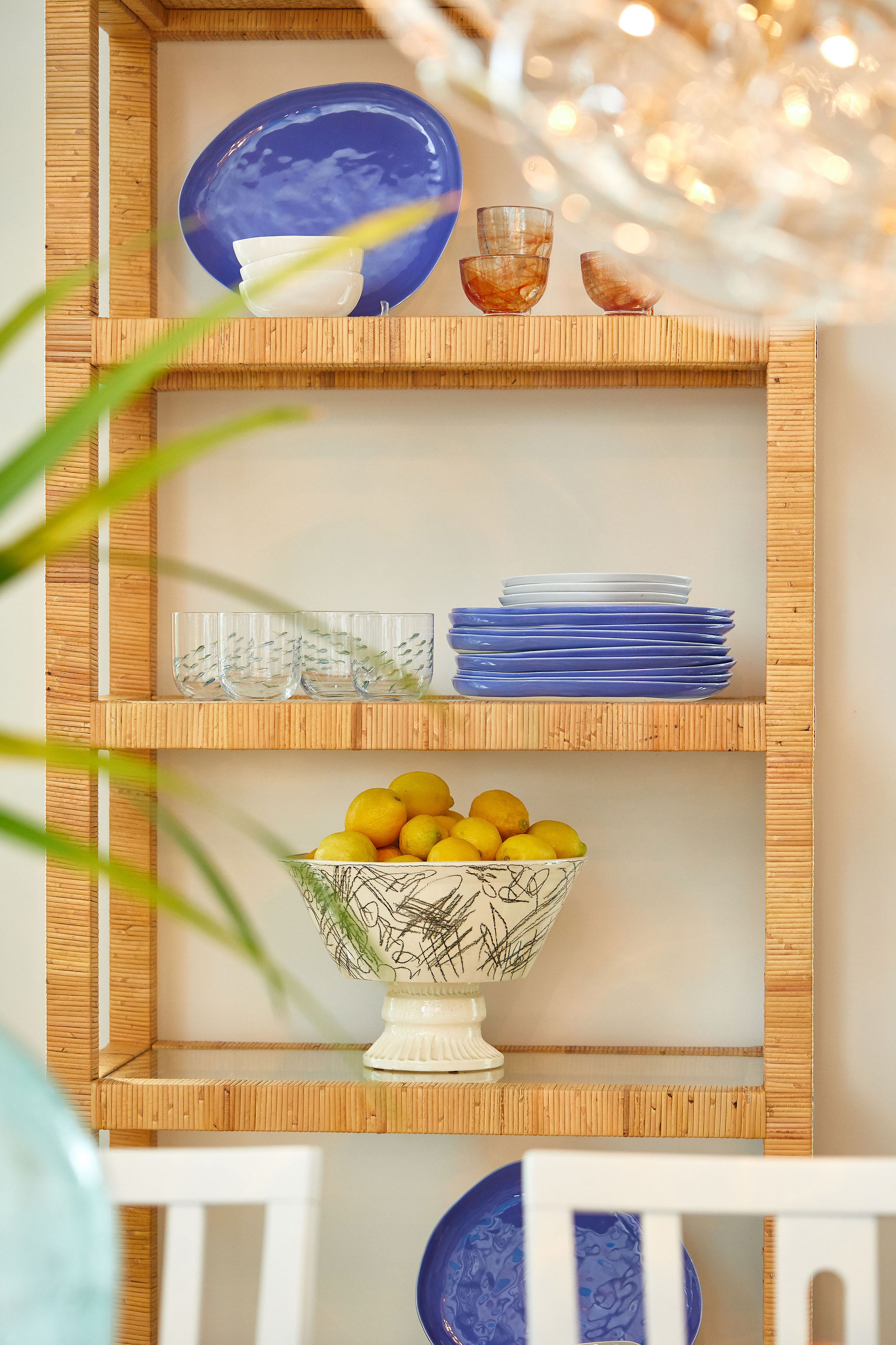 Image of an etagere with lemons and plates