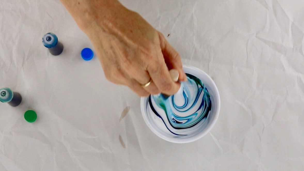 A mixing bowl filled with food coloring