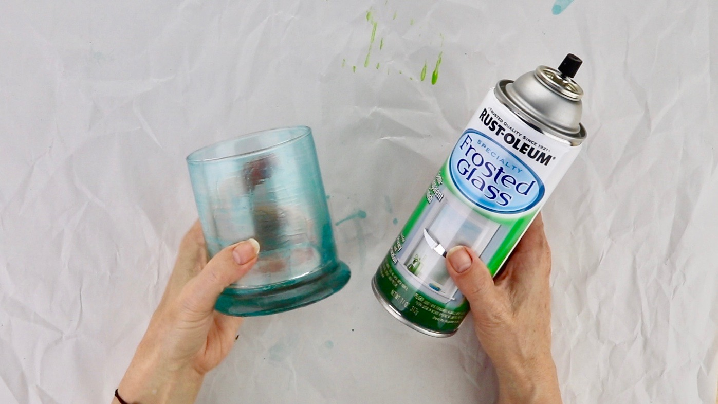a glass and a can of spray paint