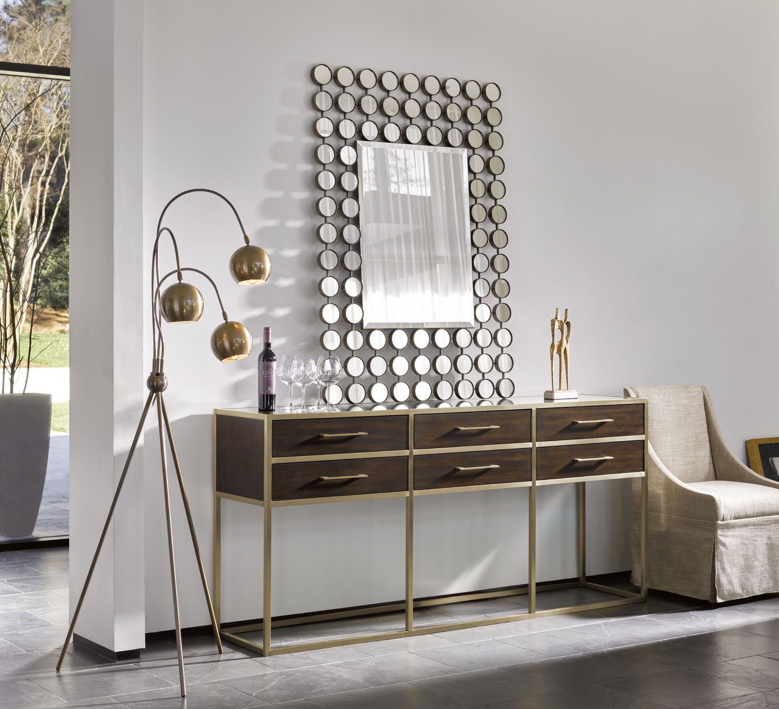 Brown console table with a mirror on top of it