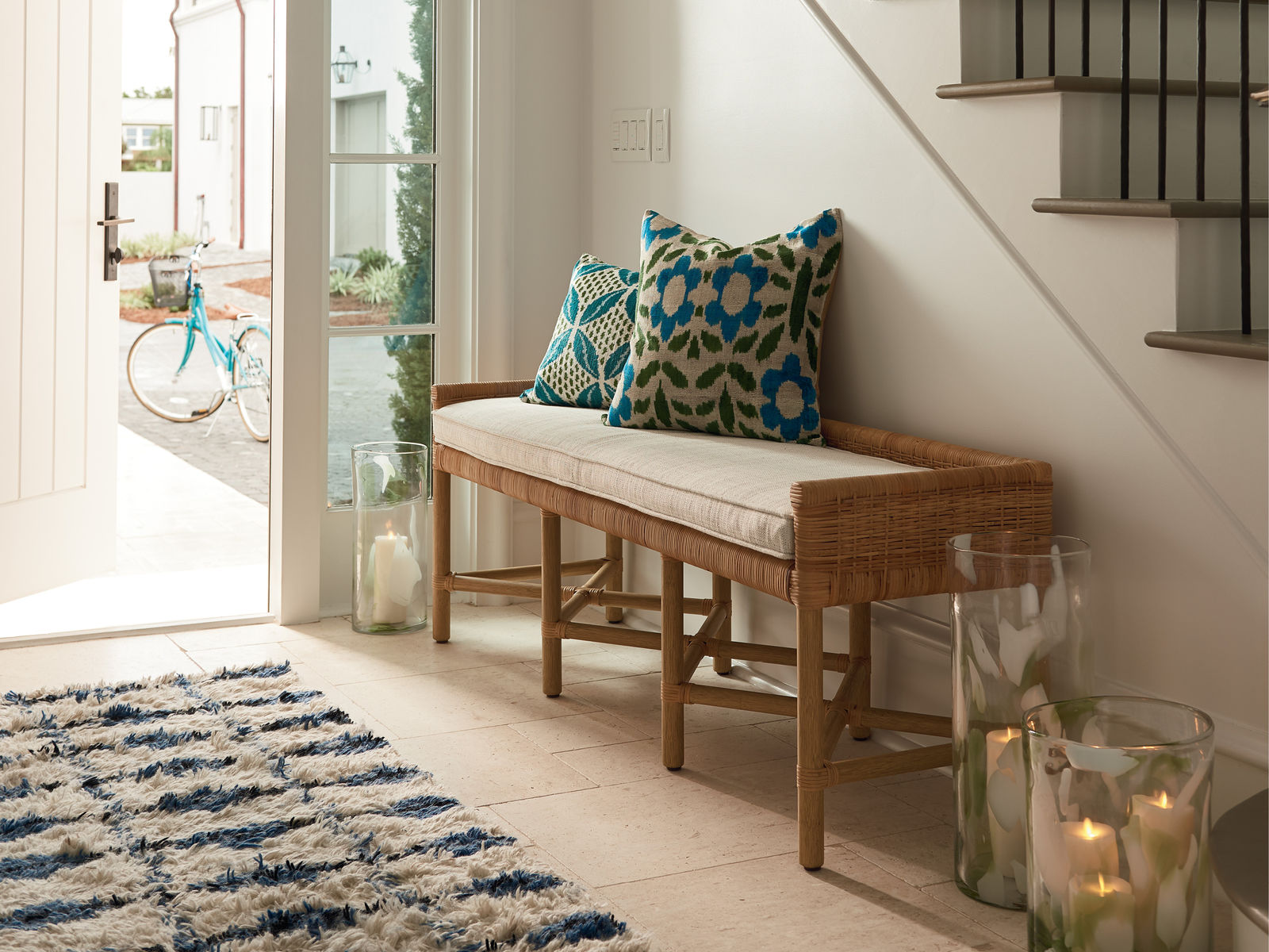Bench with blue pillows on it