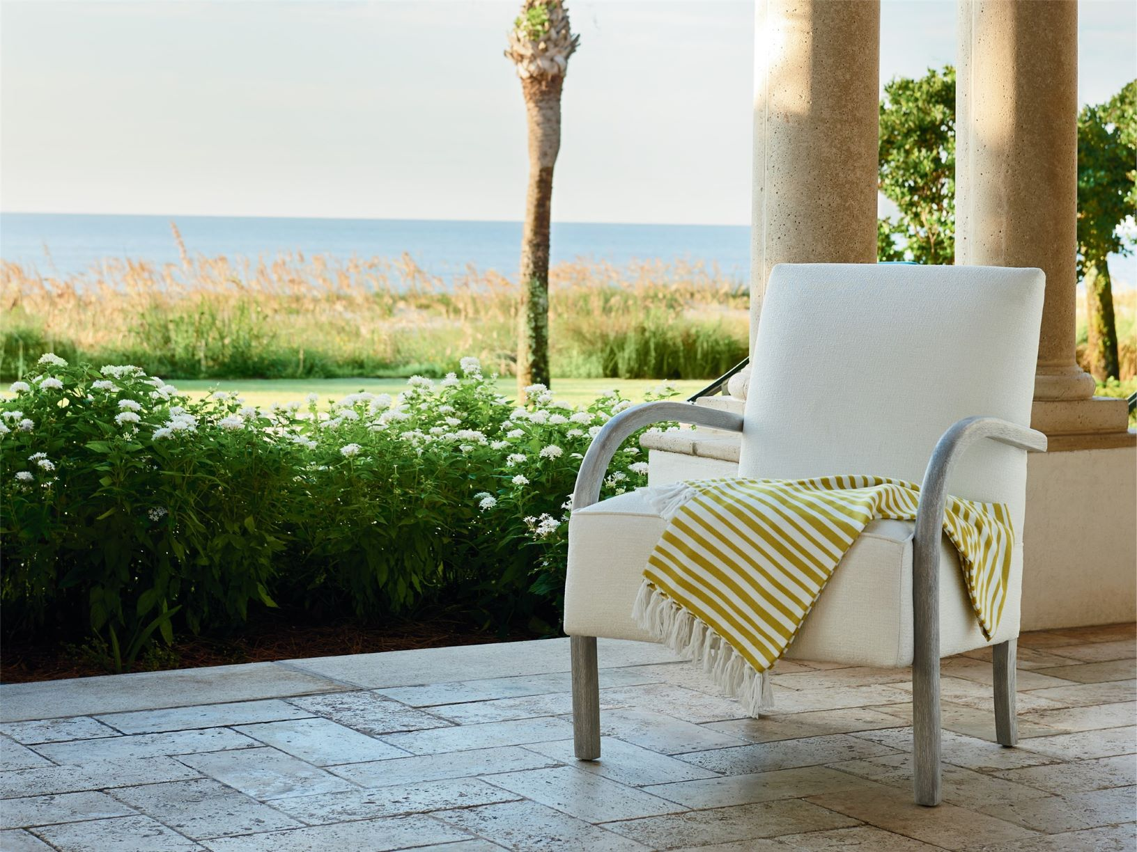 Chair on a porch overlooking the ocean