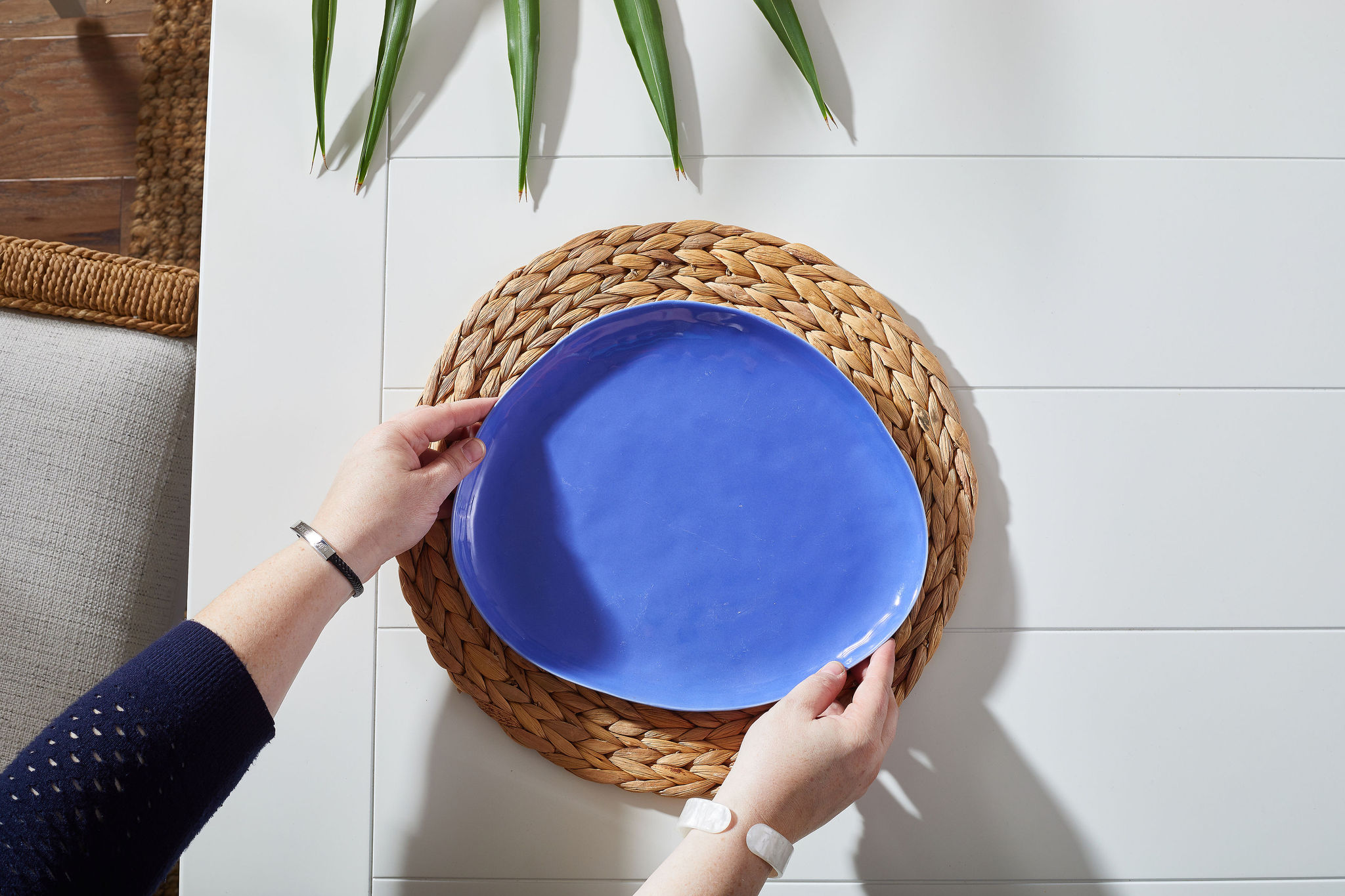 Woven placemat with a blue plate on top
