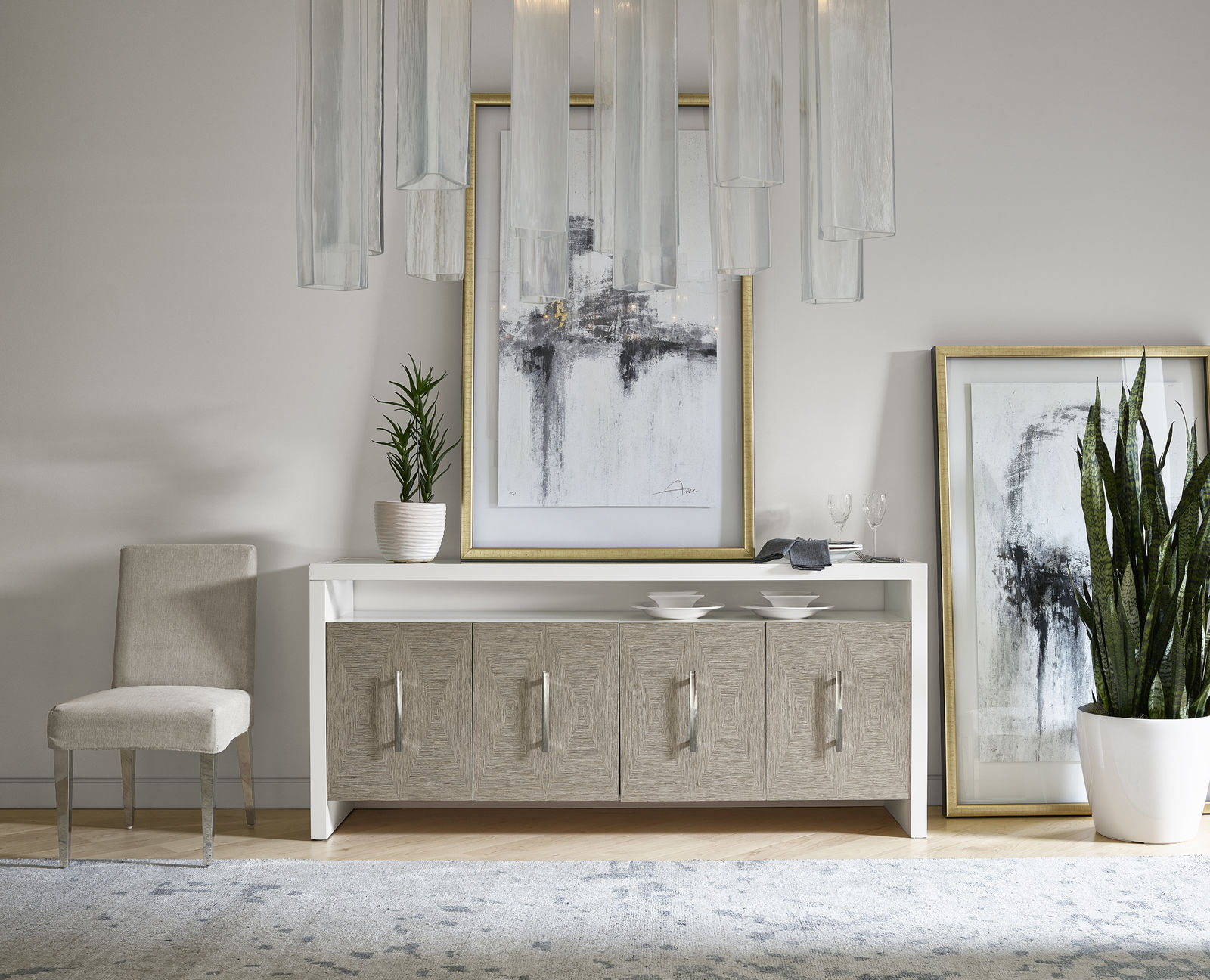 Dining room sideboard with art resting on top