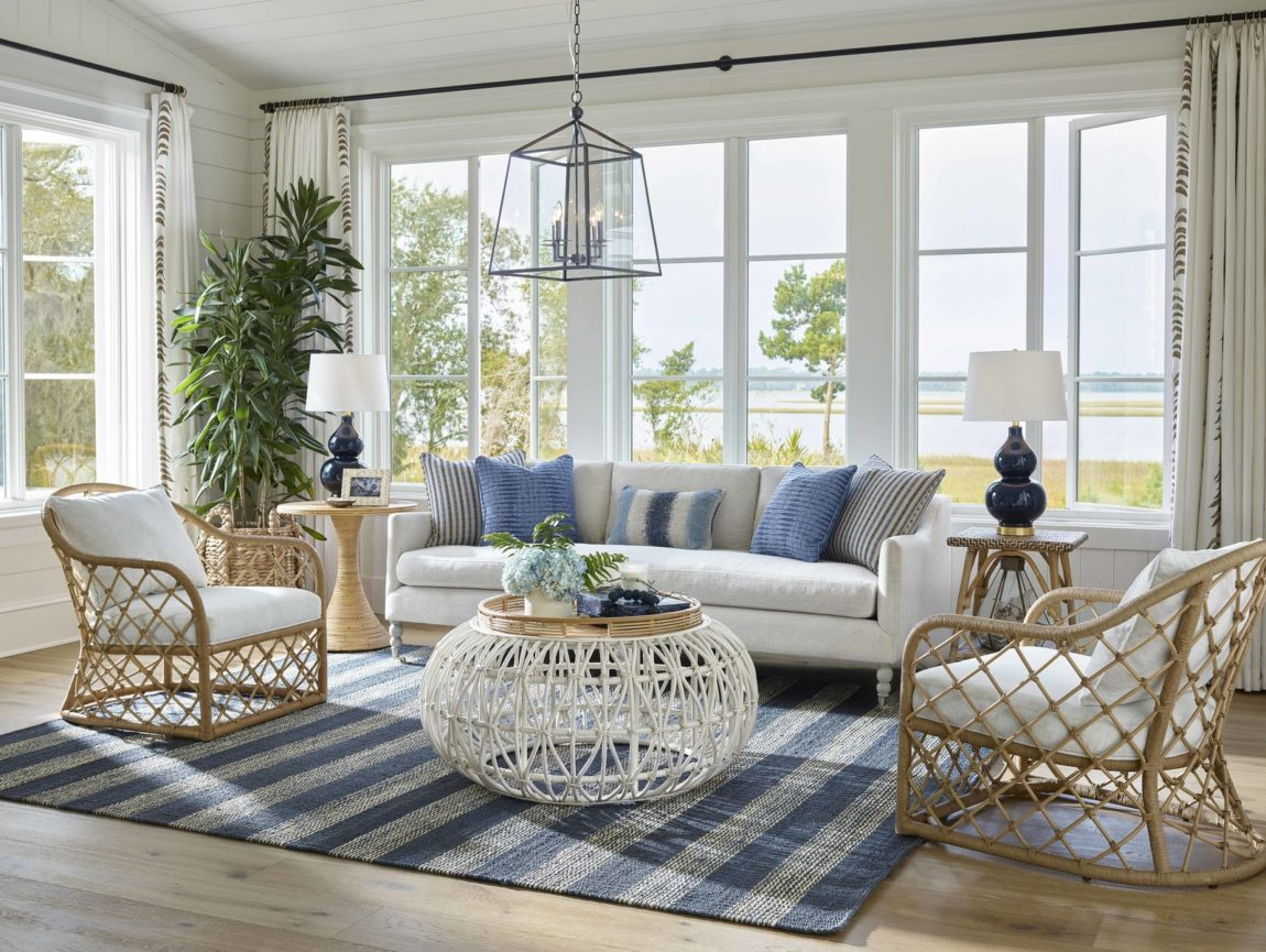 living room with furniture placed half on rug, half off